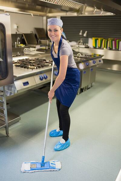 Woman mopping kitchen